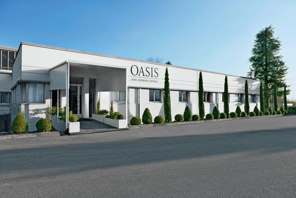 Вход в современное здание фабрики Oasis.