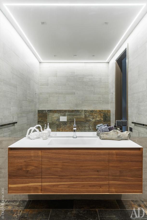 Гостевой санузел. Стены и пол выложены плиткой, Apavisa. Мебель, Antonio Lupi.